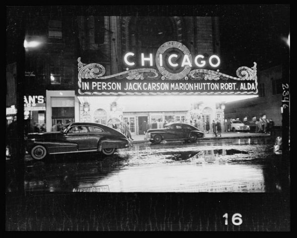 People-arriving-at-a-Chicago-theater-for-show-starring-in-person-Jack-Carson-Marion-Hutton-and-Robert-Alda-598x479